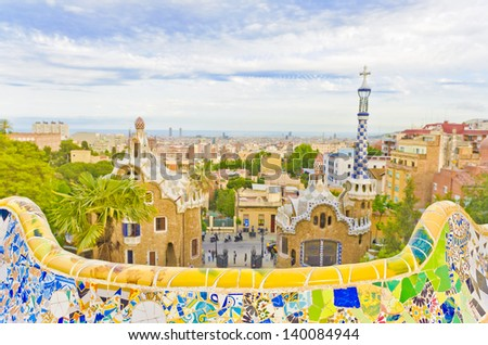 Views from the Parc Guell designed by Antoni Gaudi (focus on the ceramic bench), Barcelona, Spain. - stock photo