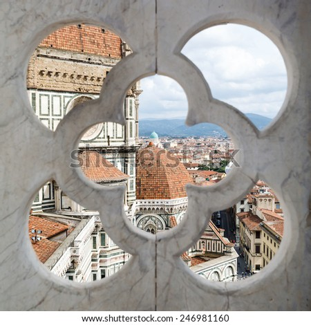 views of the Cathedral Santa Maria del Fiore through the fence ornament bell tower in Florence, Italy - stock photo