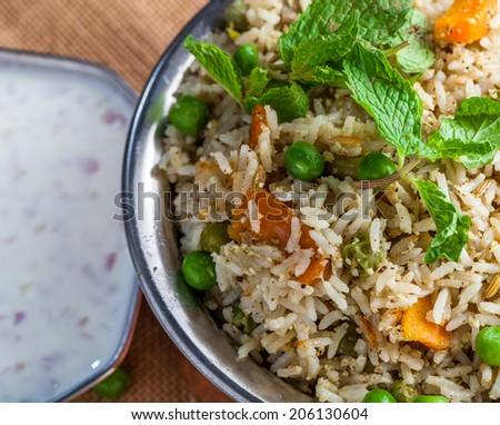 Vigetable Briyani - basmati rice vith herbs and raitha - stock photo