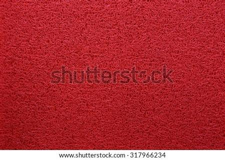Vignette Red Coil Pattern Car Floor Mat Background Texture - stock photo