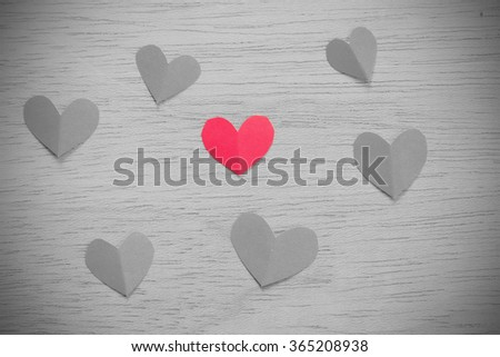Vignette Style, Series of Valentines Card. Seven Red heart paper cut on wooden background. Image of Valentines day. Photoshop Vintage Effect. Selective Color. - stock photo
