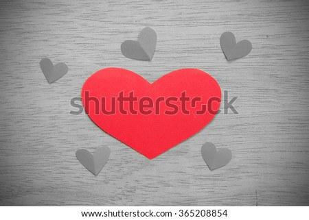 Vignette Style, Series of Valentines Card. Six Red heart paper cut on wooden background. Image of Valentines day. Photoshop Vintage Effect. Selective Color. - stock photo