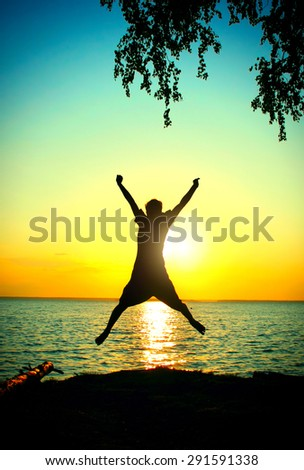 Vignetting Photo of Happy Person jump on the Sunset Background at Seaside