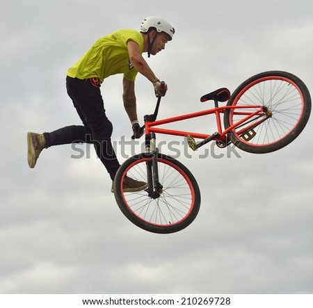 VIGO (PONTEVEDRA), SPAIN - AUGUST 9, 2014: The urban culture festival and extreme sports O Marisquino celebrate its 14th edition tests BMX and Dirty with large crowds and good sportmanship level. - stock photo