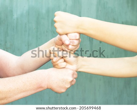 vigorous hand of a young girl and an old woman - stock photo