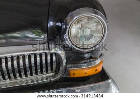 VIHULA, ESTONIA - JULY 11, 2015: Rear head-light and grille of old soviet car GAZ 21 in the Vihula Manor Museum. - stock photo