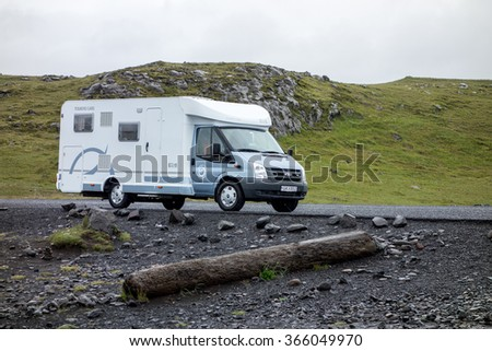 VIK, ICELAND - JUNE 30: Blue-white Ford Transit caravan car in the landscape of Iceland near the Vik town. Caravaning is very popular in Iceland. The image was taken on June 30, 2014.