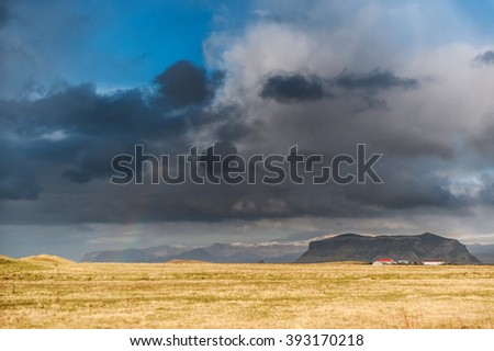 VIK, ICELAND - OCTOBER 16, 2014: Landscape in Iceland. Mountain and Cloudy Sky. Close to Black Sand Beach.