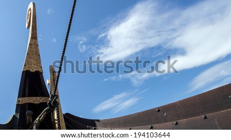 Viking ship's stern seen from the hull from below, showing the curved lines of a viking ship - stock photo