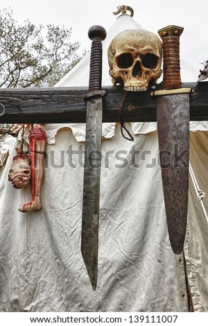 Viking tent with swords and body parts in the Medieval Castle Festival