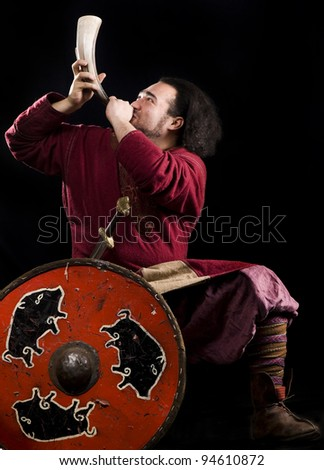 Viking with horn - stock photo