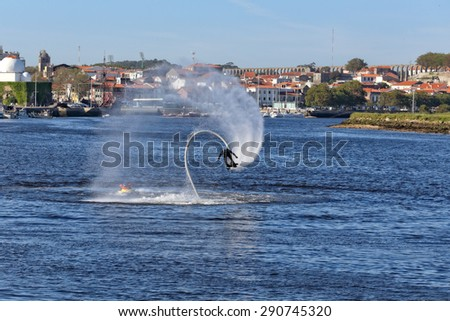 Vila do Conde, Portugal - May 16, 2015: Flyboard training and demonstration in the mouth of the Ave river - stock photo