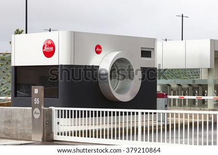 Vila Nova de Famalicao, Portugal. March, 2013: Entrance of the new factory of the iconic Leica in Portugal, shaped as a camera. Inaugurated in March 2013, after 40 years in the previous facilities. - stock photo