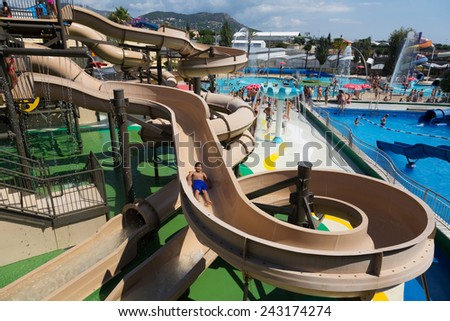 VILASSAR DE DALT, SPAIN - AUGUST 30, 2014: Water slide at Illa Fantasia Barcelona's Water Park. 22 Attractions, 3 giant swimming pools and picnic area