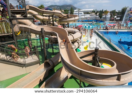 VILASSAR DE DALT, SPAIN - AUGUST 30, 2014: Water slide at Illa Fantasia Barcelona's Water Park. 22 Attractions, 3 giant swimming pools and picnic area for the whole family