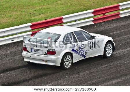 VILKYCIAI,LITHUANIA-JULY 11:rider overcomes the track in the Rallycross Challenge Europe and NEZ Crosskart Championship 2015 on July 11,2015 in Vilkyciai,Lithuania. - stock photo