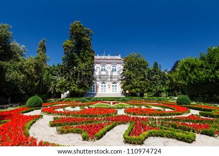 Villa Angiolina With a Beautiful Flowerbed Before an Entrance, Opatija, Croatia - stock photo