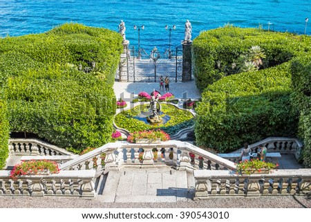 VILLA CARLOTTA, ITALY - AUGUST 02, 2015: Beautiful stairway leading down to the fountain in green garden, villa Carlotta, Como lake, Italy. - stock photo