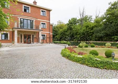 Villa exterior - cobblestone road  - stock photo