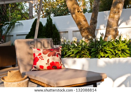 Villa garden with Sunlounger in the beautiful afternoon sun - stock photo