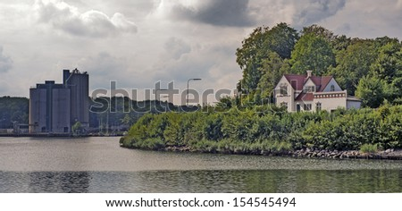 Villa, water and harbor in  Denmark - stock photo