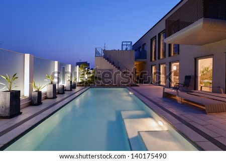 Villa with swimming pool night view-3 - stock photo