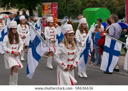 VILLACH, AUSTRIA - AUGUST 7: The procession with participants from allover Europe at the 'Villacher Kirchtag', the largest traditional folk festival in Austria, August 7, 2010 in Villach, Austria