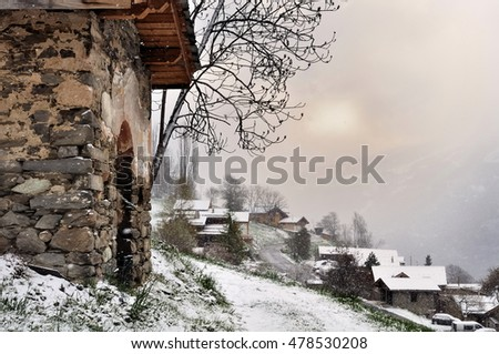 village in mountain under snow fall