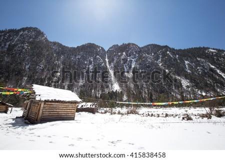 Village in snow - stock photo