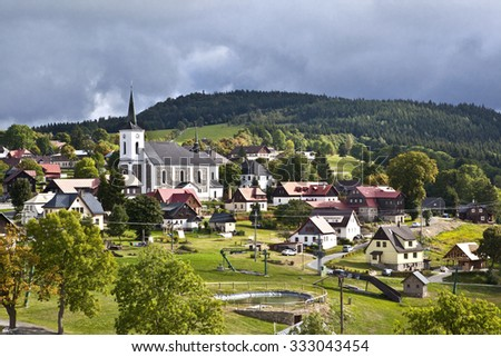 Village in the Jizerske hory mountains in the Czech republic in the autumn - stock photo