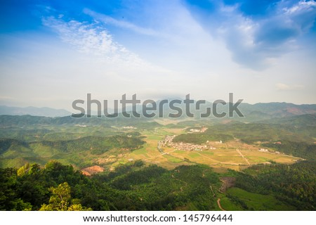 village in the valley in the morning - stock photo