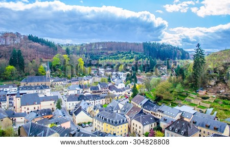 village Larochette in Luxembourg is famous for ruins of medieval castle and it is surrounded by forests forming mullerthal region. - stock photo