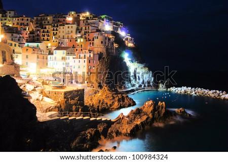 Village of Manarola, Italy on the Cinque Terre coast at night - stock photo