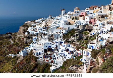 Village of Oia and the caldera at Santorini island in aegean, Cyclades, Greece - stock photo