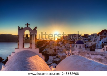 Village of Oia at sunset, Santorini, Greece - stock photo