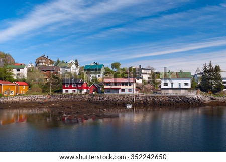 Village on the norwegian island in sunny day - stock photo
