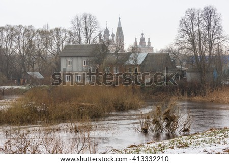Village Parskoe, river Parsha and the temple complex of churches of the beheading of John the Baptist and ascension in April. Ivanovo region. Russia.