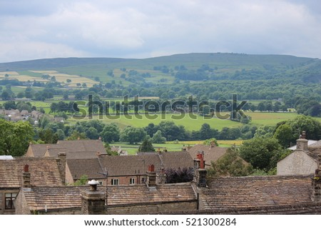 Village Rooftops With Yorkshire Dales in Background.
