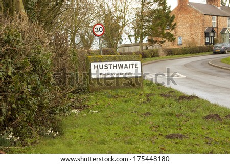 Village sign with 30 limit - stock photo