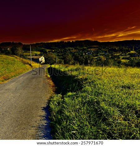 Village Surrounded by Fields in the French Limousen;  Sunset - stock photo