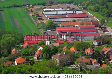 Village with farm on aerial view. - stock photo