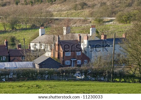 village with houses in countryside - tardebiige canal village worcestershire