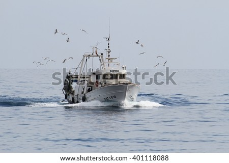 VILLAJOYOSA, SPAIN â?? MARCH  30: The Spanish trawler fishing boat Xaonell is sailing close to the coast of La Vila, on march 30, 2016 in Alicante.
