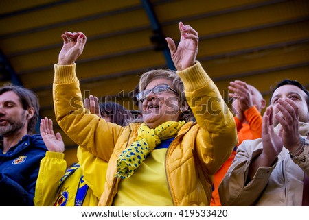 VILLARREAL, SPAIN - MAR 20: Fans at the La Liga match between Villarreal CF and FC Barcelona at El Madrigal Stadium on March 20, 2016 in Villarreal, Spain. - stock photo