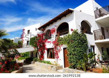 Villas decorated with flowers at luxury hotel, Crete, Greece - stock photo