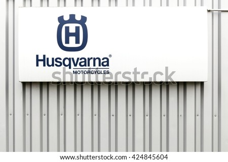 Villefranche, France - March 20, 2016: Husqvarna  motorcycles logo on a facade.  Husqvarna is swedish a manufacturer of robotic mowers, garden tractors, chainsaws, trimmers, bicycles and motorcycles - stock photo