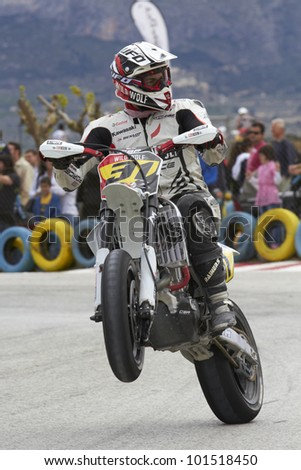 VILLENA, SPAIN - MAY 29: Israel Escalera pulls a wheelie at in the Spanish championship of supermotard on May 29, 2012, Villena Spain - stock photo