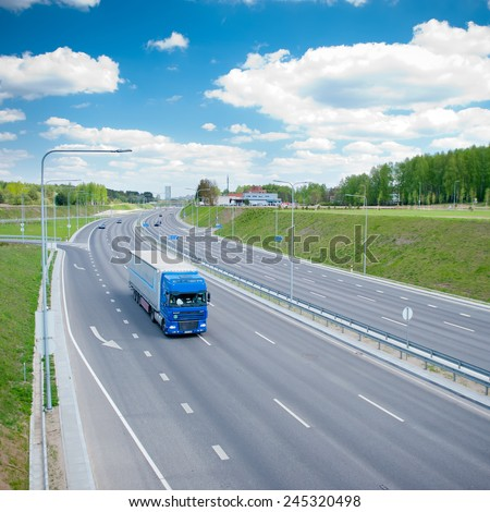 VILNIUS - APR 29: DAF XF truck on motorway on Apr. 29, 2014 in Vilnius, Lithuania. The DAF XF is a range of trucks produced by the Dutch manufacturer DAF since 1997. - stock photo