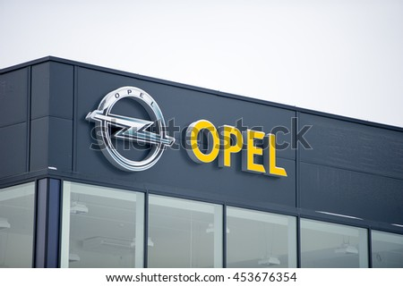 VILNIUS - DEC 29: Opel official dealership logo on Dec. 29, 2015 in Vilnius, Lithuania. Adam Opel AG is a German automobile manufacturer and a subsidiary of the American General Motors Company.