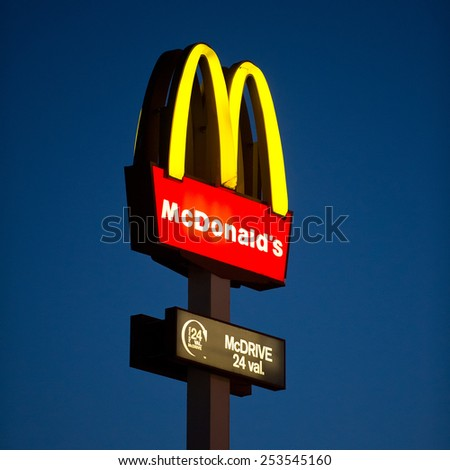 VILNIUS - FEB 16: McDonalds logo at night on Feb. 16, 2015, Vilnius, Lithuania. McDonald's is the world's largest chain of hamburger fast food restaurants, serving around 68 million customers daily. - stock photo